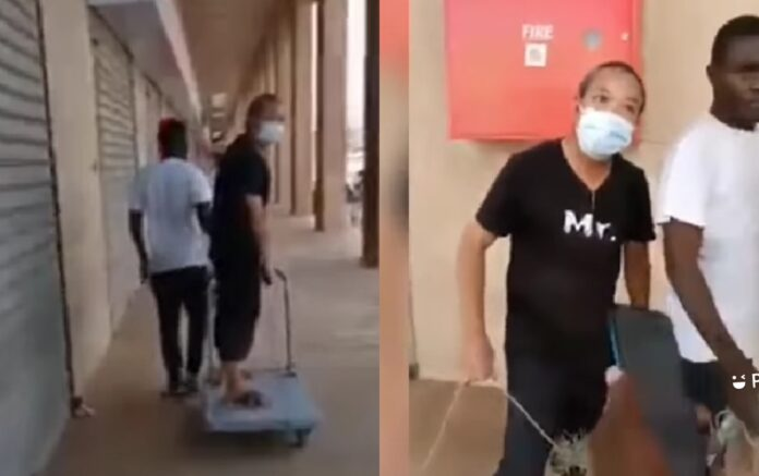 Chinese Man In Zambia Employs Man Who Pulls Him Around With Trolley